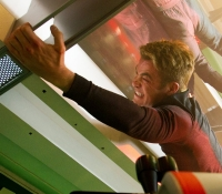 Kirk (Chris Pine) hangs on