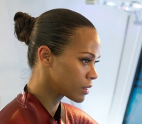 Uhura (Zoe Saldana) gets serious in her tight uniform