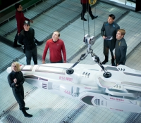 Looking down at Carol (Alice Eve), Scotty (Simon Pegg), Bones (Karl Urban) and Kirk (Chris Pine)