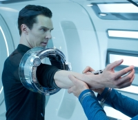 Bones (Keith Urban) examines John Harrison (Benedict Cumberbatch)