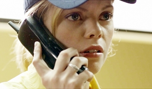 Dreama Walker takes a call in 'Compliance'