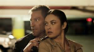 Aaron Eckhart and Olga Kurylenko are old friends who meet again in &#039;Erased&#039;