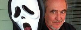 "Wes Craven holding up the head of ""Ghostface"""
